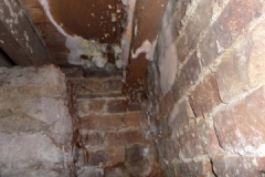 Dry rot in floor due to an escape of water from a bath to wall joint